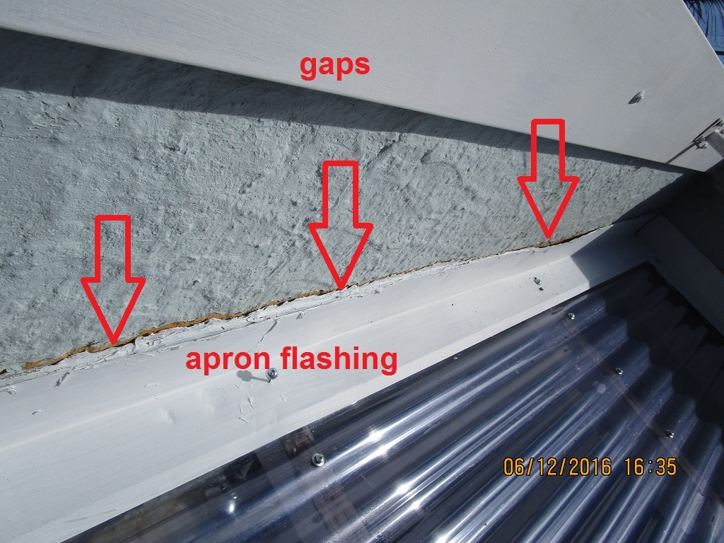 Showing gaps in apron flashing which could lead to building damage: taken as part of a house inspection report