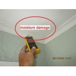Non-invasive moisture testing probe reading moisture levels in the ceiling