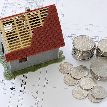 a half built house with a pile of coins that could be an investment property that needs a pre-purchase rental property inspection